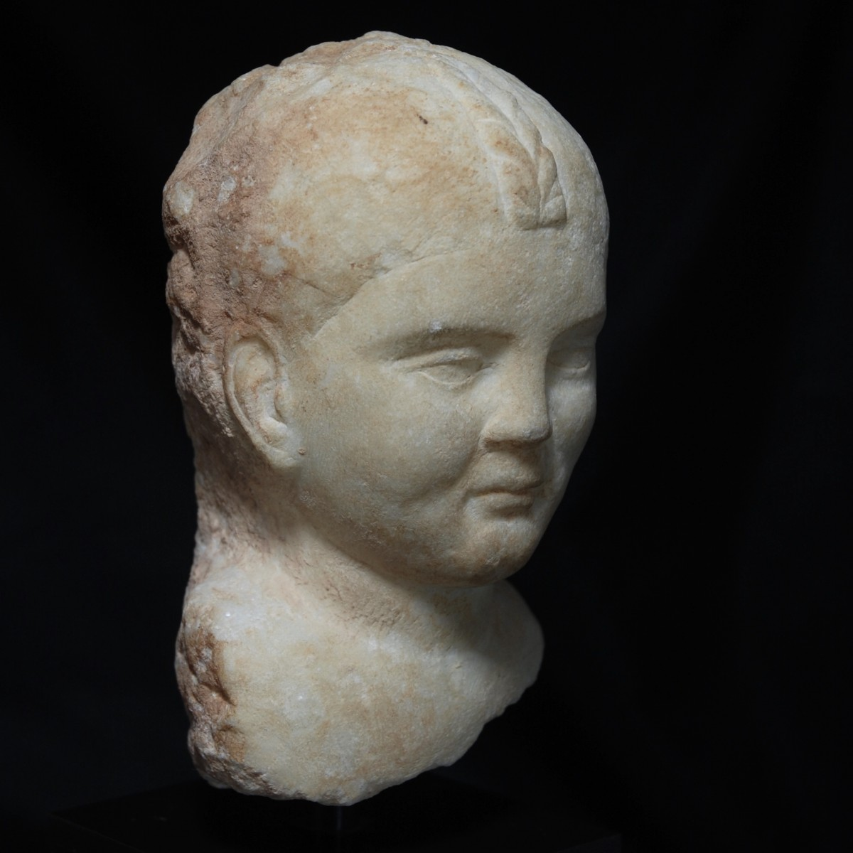 Roman Marble head of girl with braided hair right