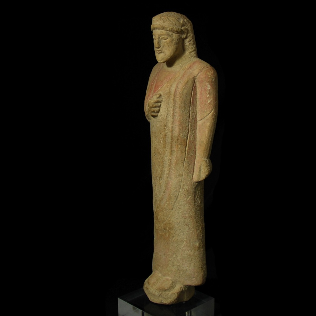 Cypriot limestone statue of a votary half left