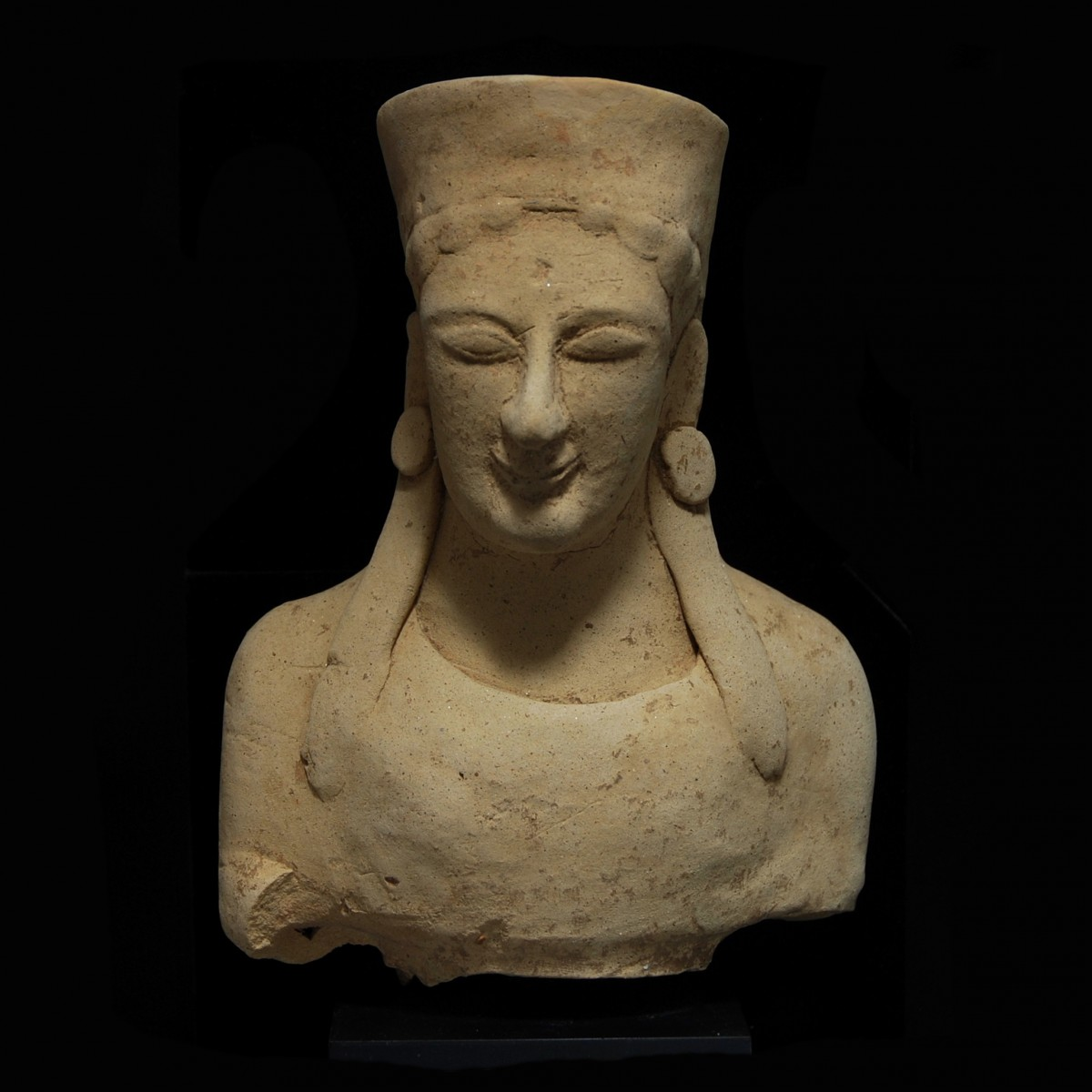 Archaic greek terracotta bust front