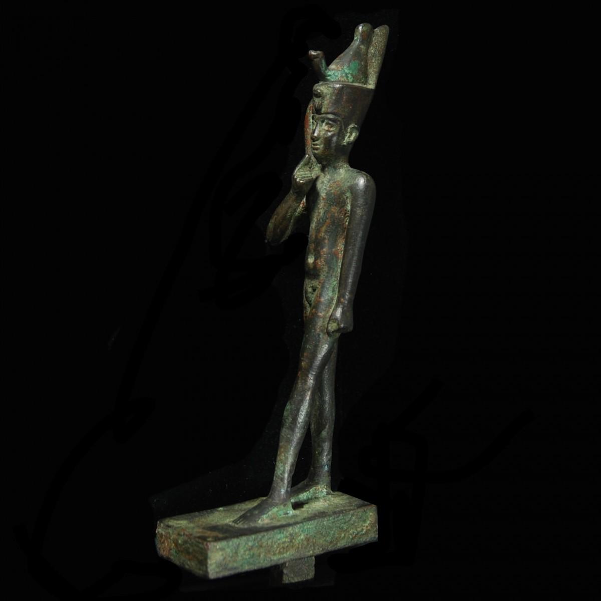 Egyptian Bronze statuette of Harpocrates half left