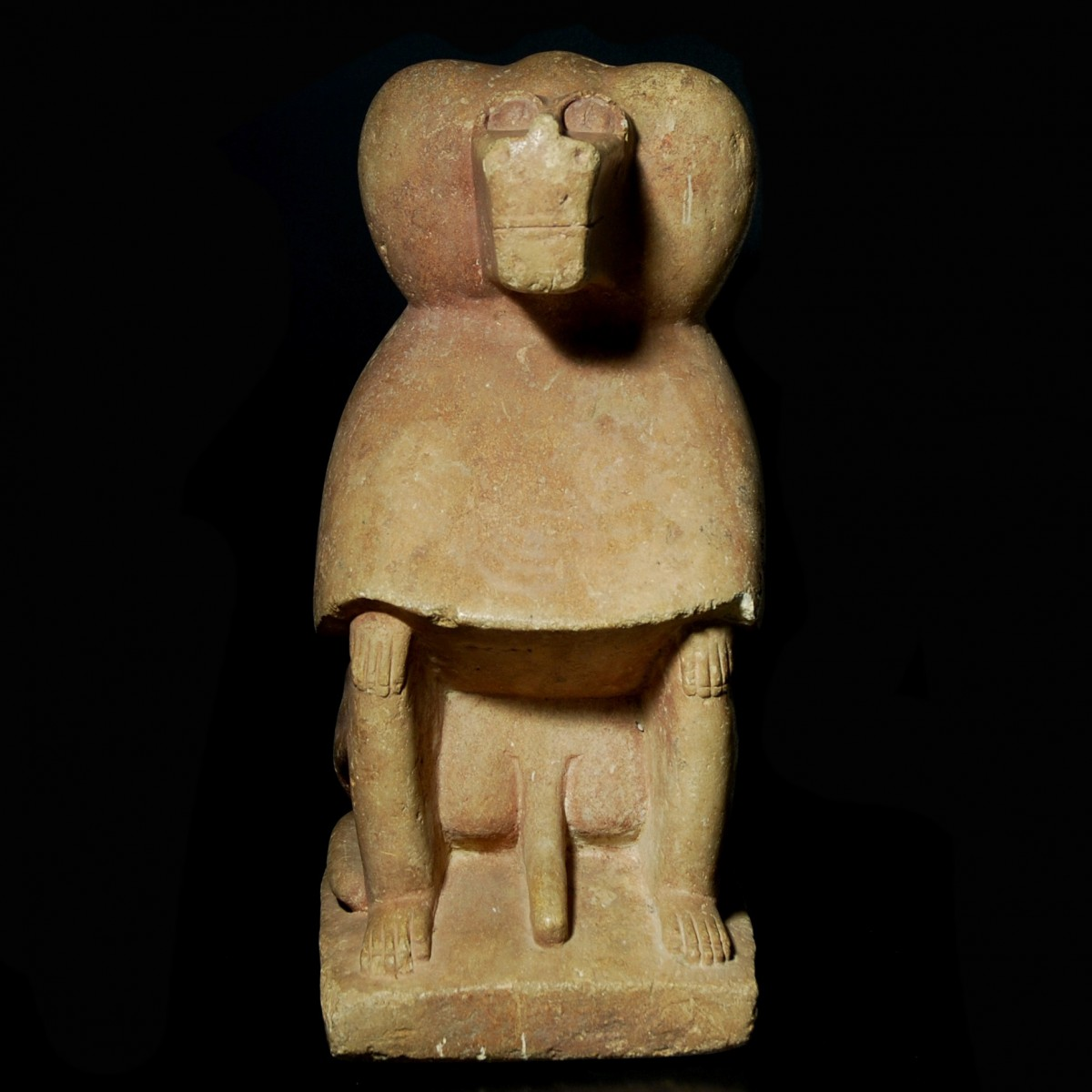 Egyptian monumental limestone seated baboon front