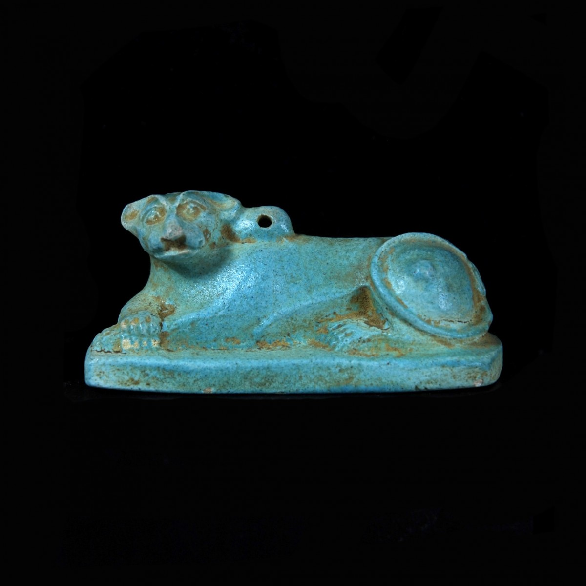 Egyptian faience amulet of a lion