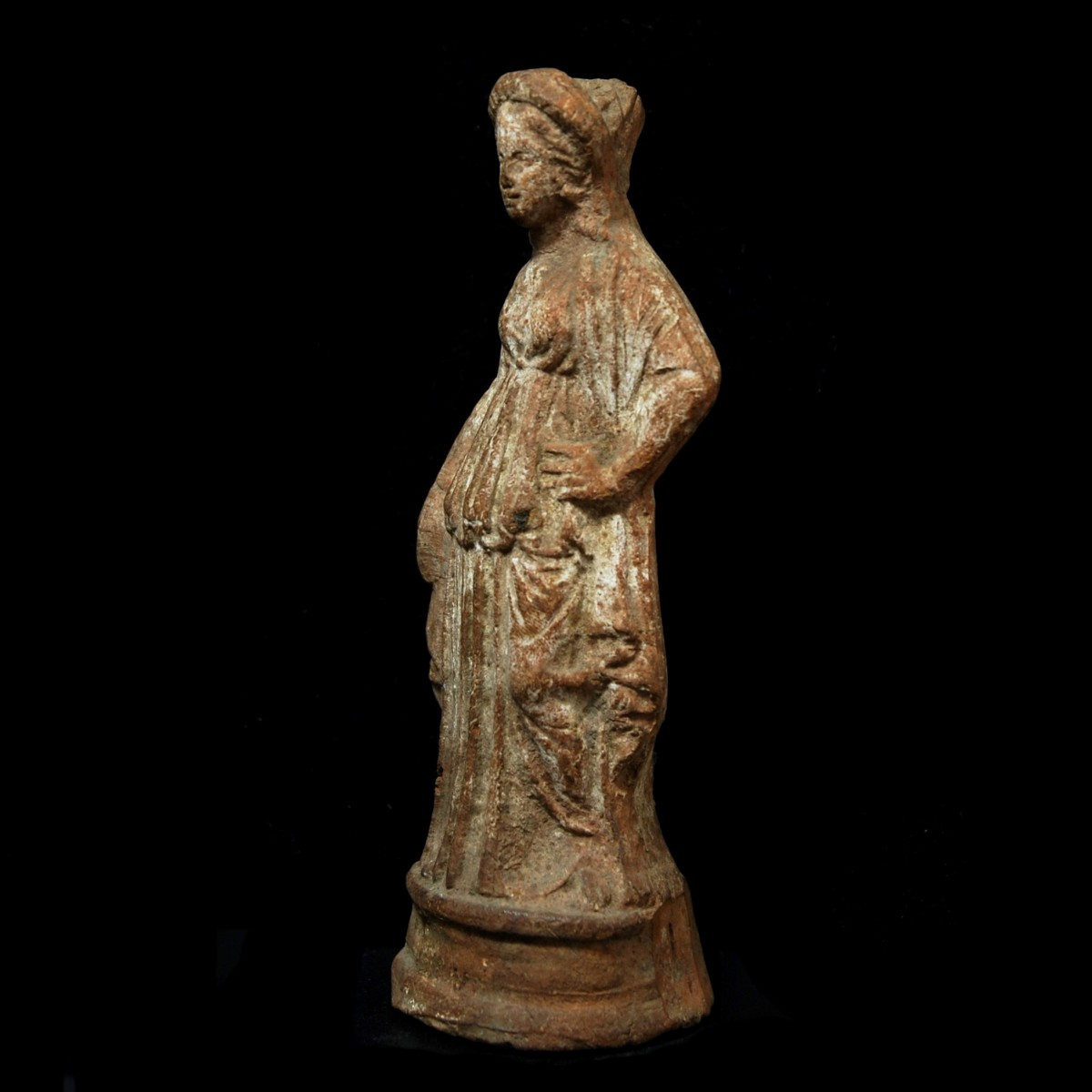 Cypriot terracotta statue of a woman half left