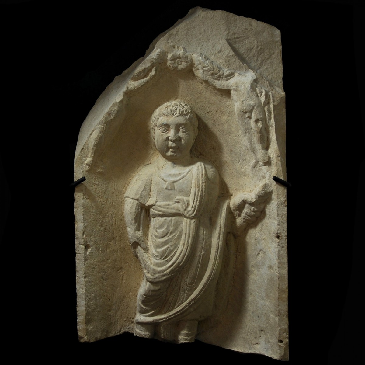 Roman limestone stele with the portrait of a boy province africa