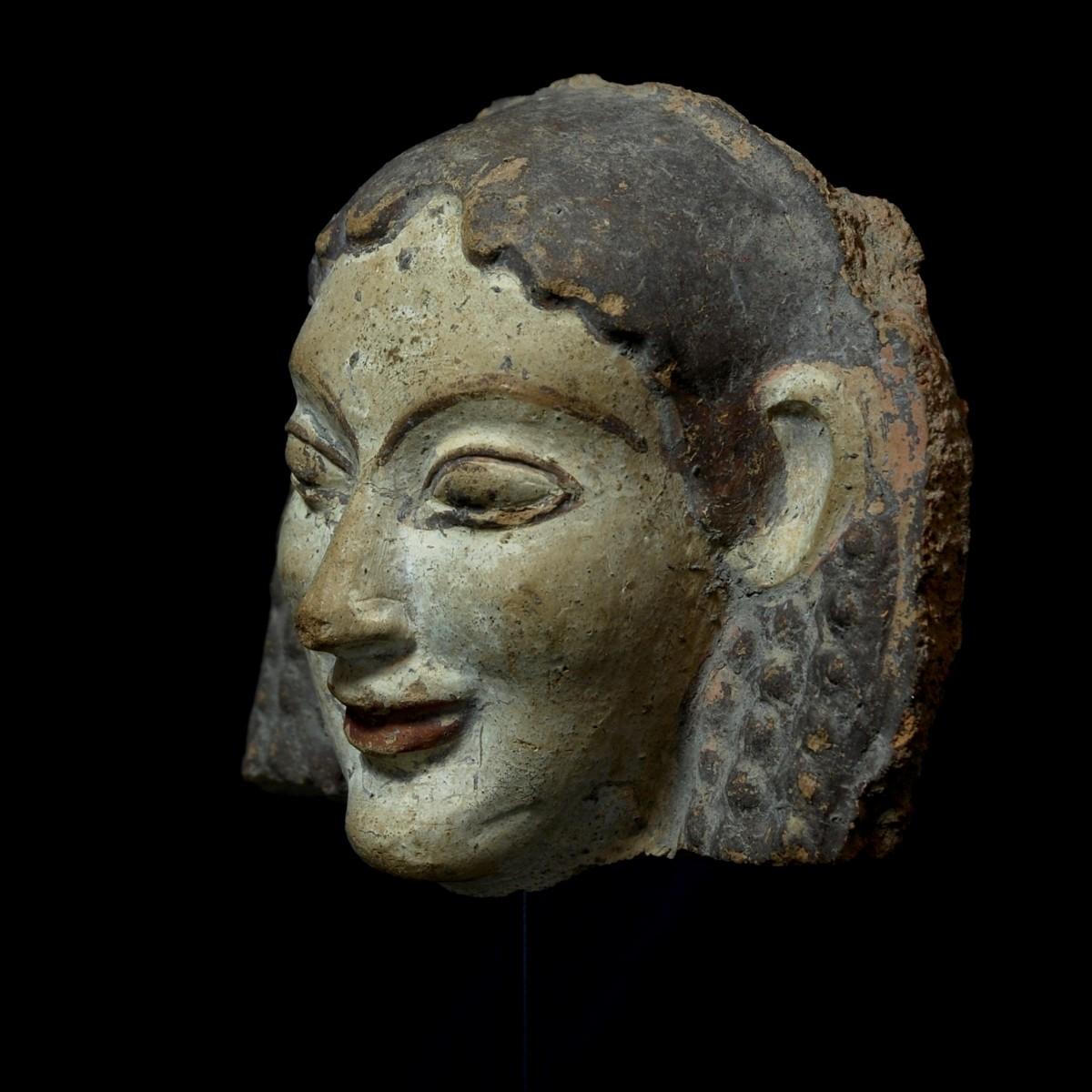 Etruscan archaic antefix half left