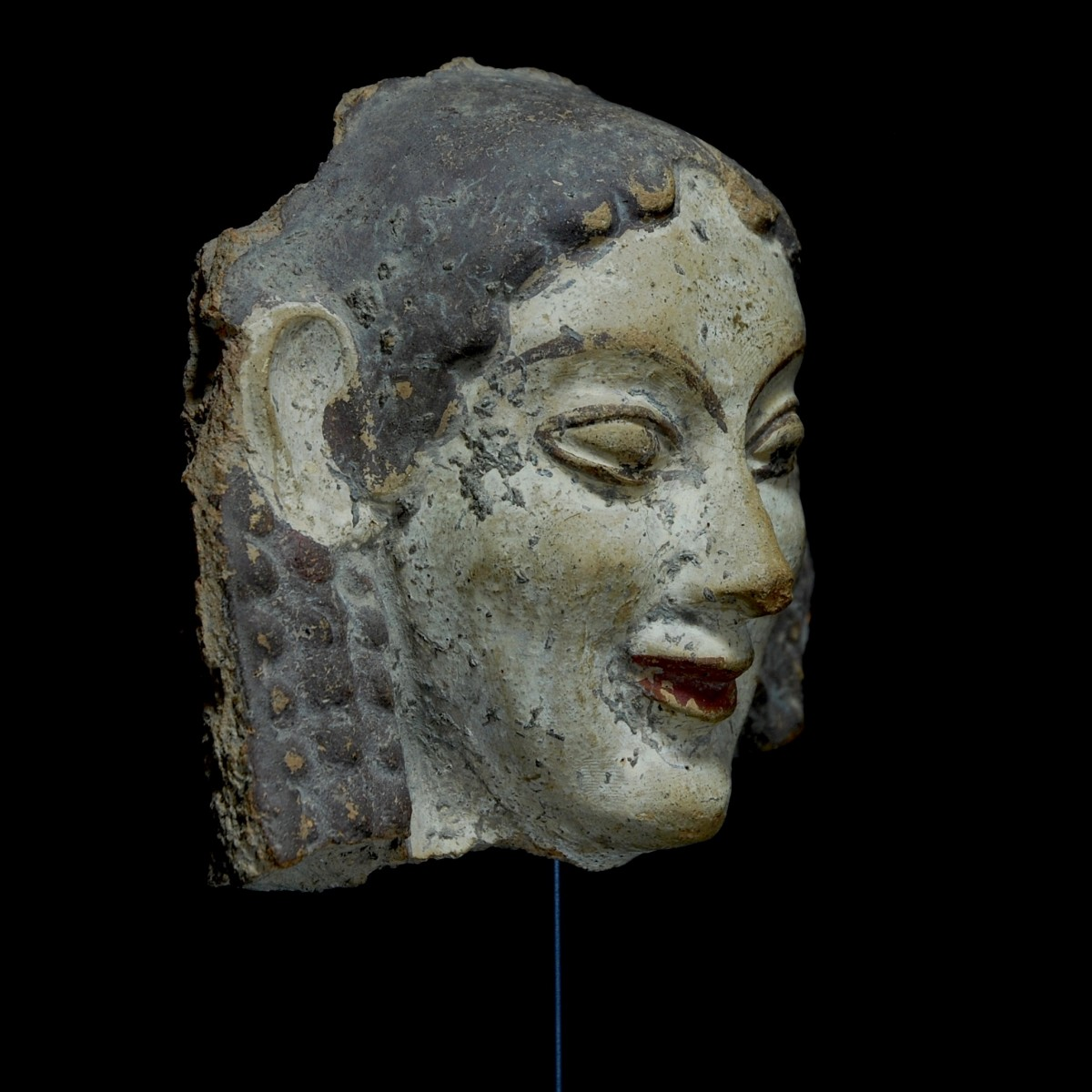 Etruscan archaic antefix half right