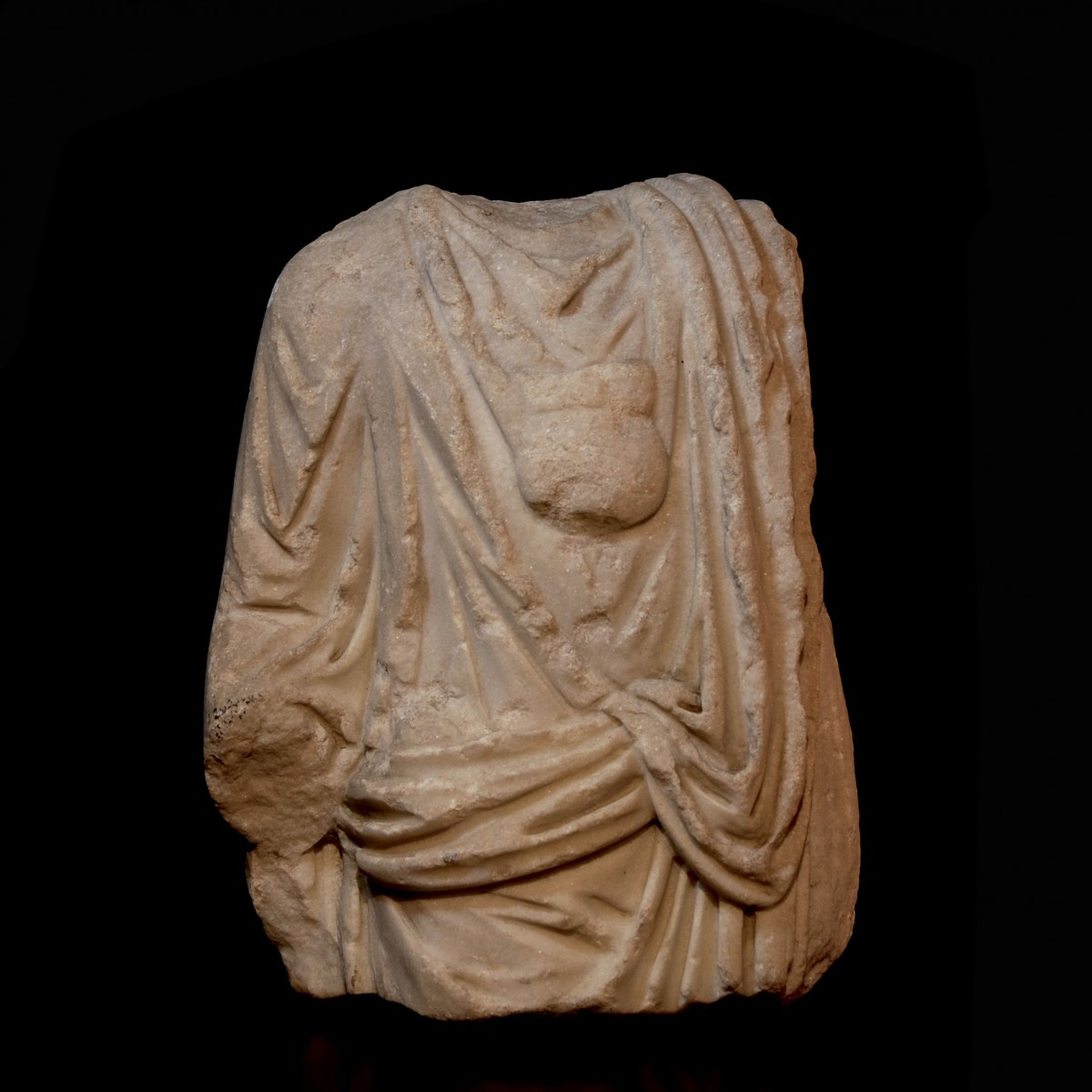 Roman marble togatus with bulla front