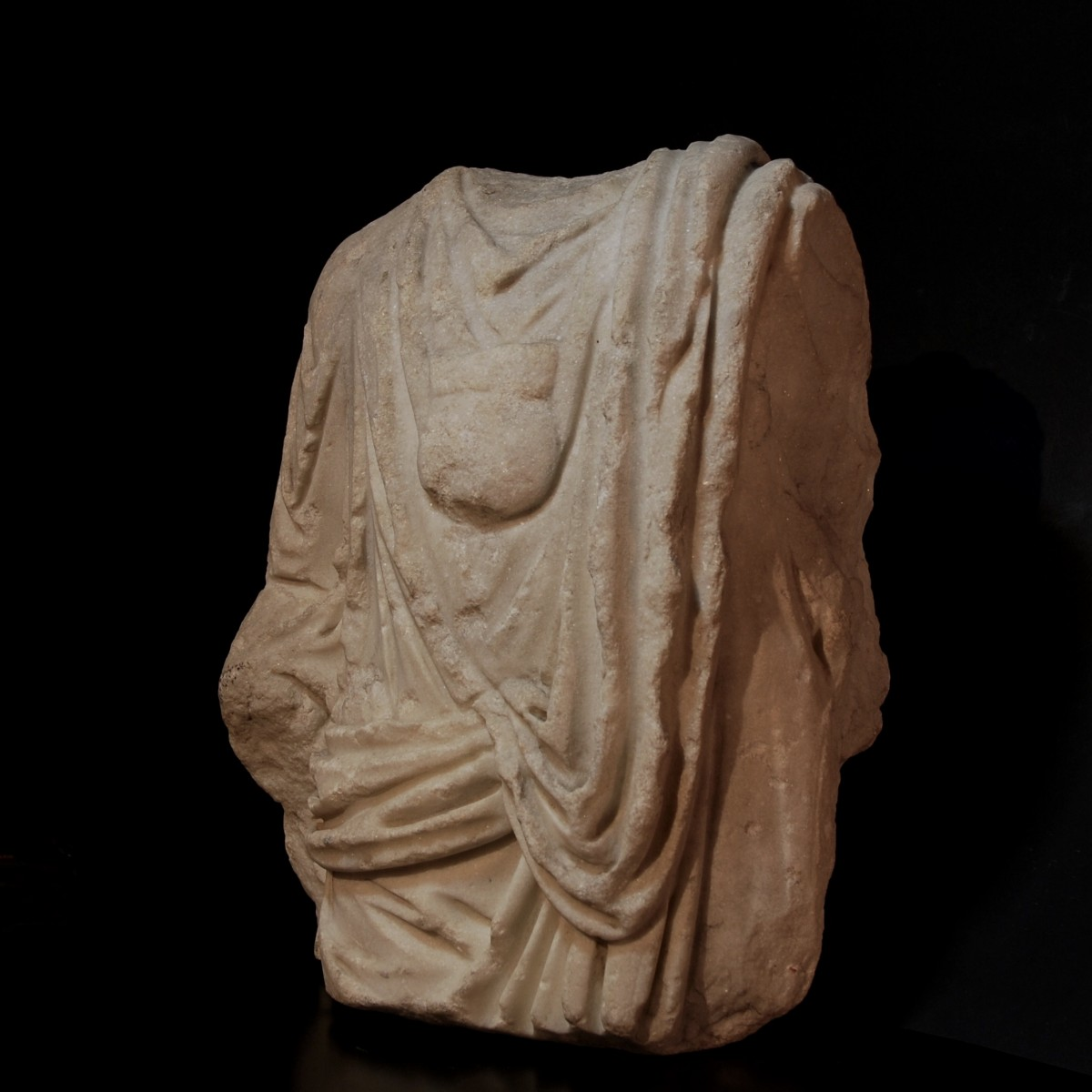 Roman marble togatus with bulla half left