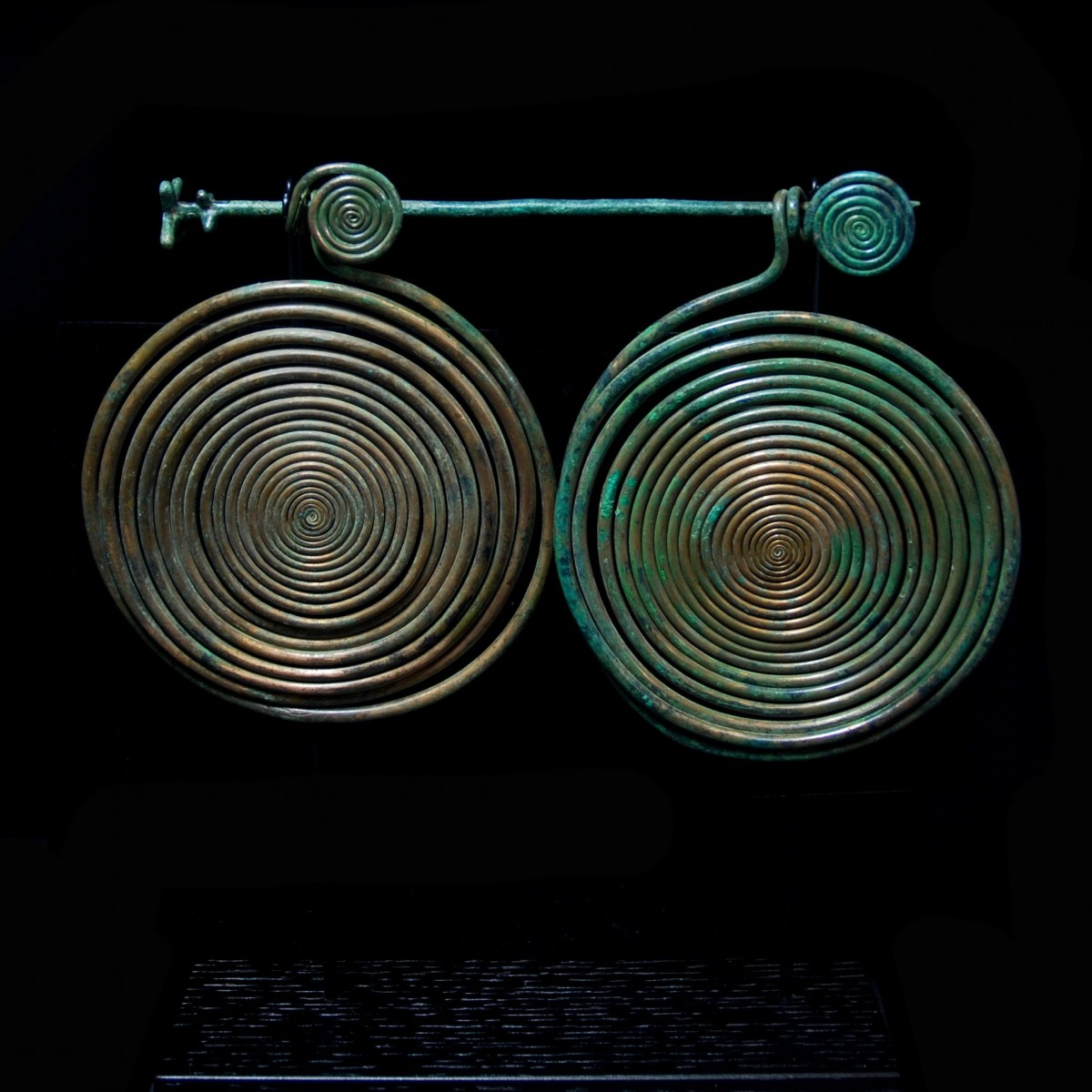 Large Bronze spirals with pin