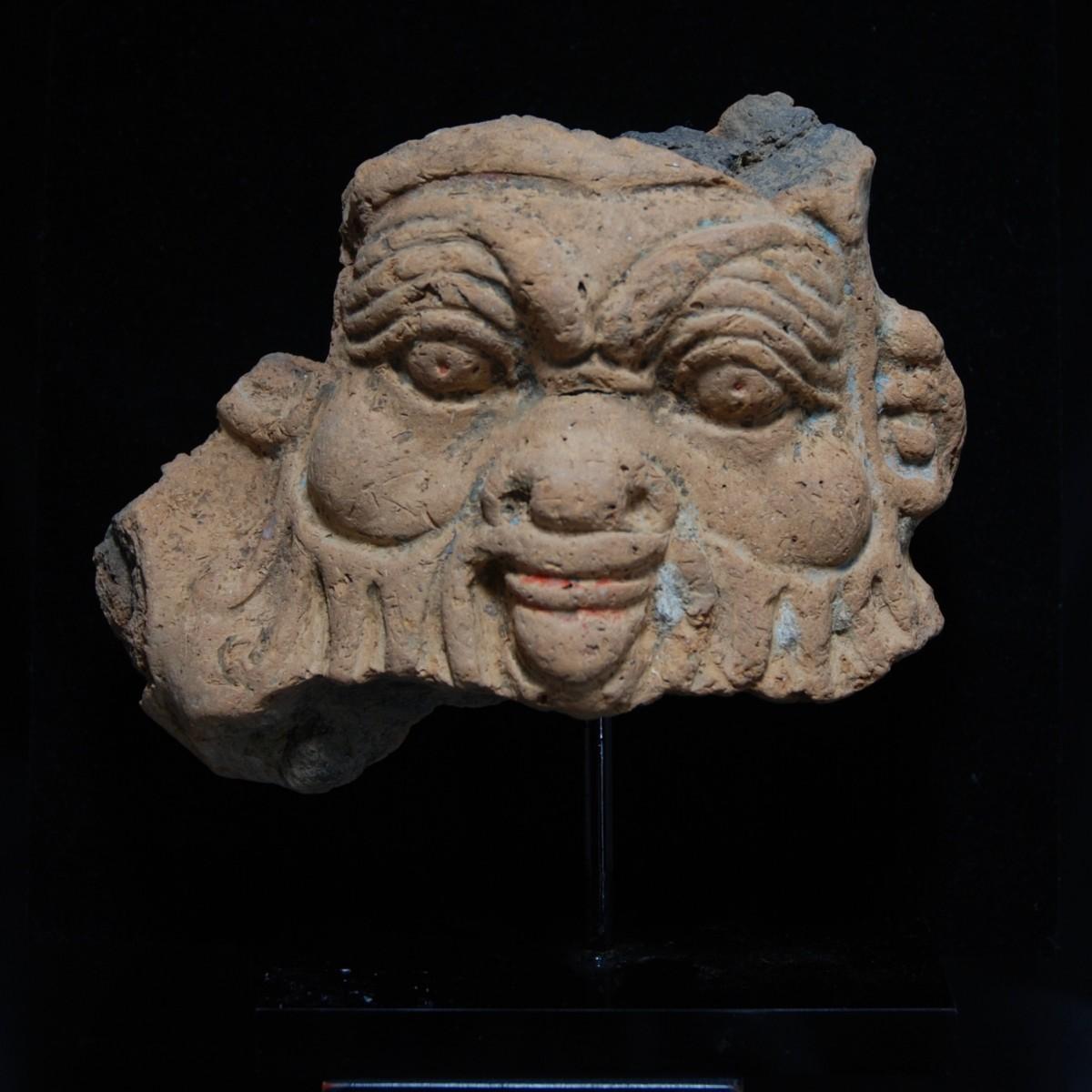 Egyptian terracotta fragment of a Bes head