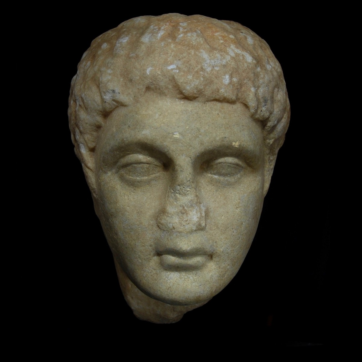 Greek marble relief head front