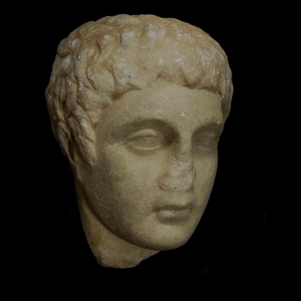 Greek marble relief head of a youth