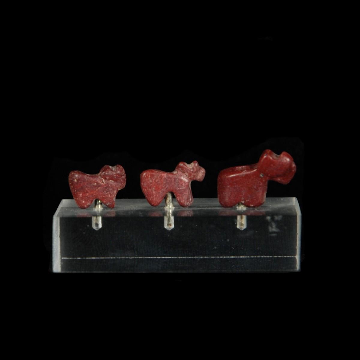 Three Sumerian red jasper ram amulets
