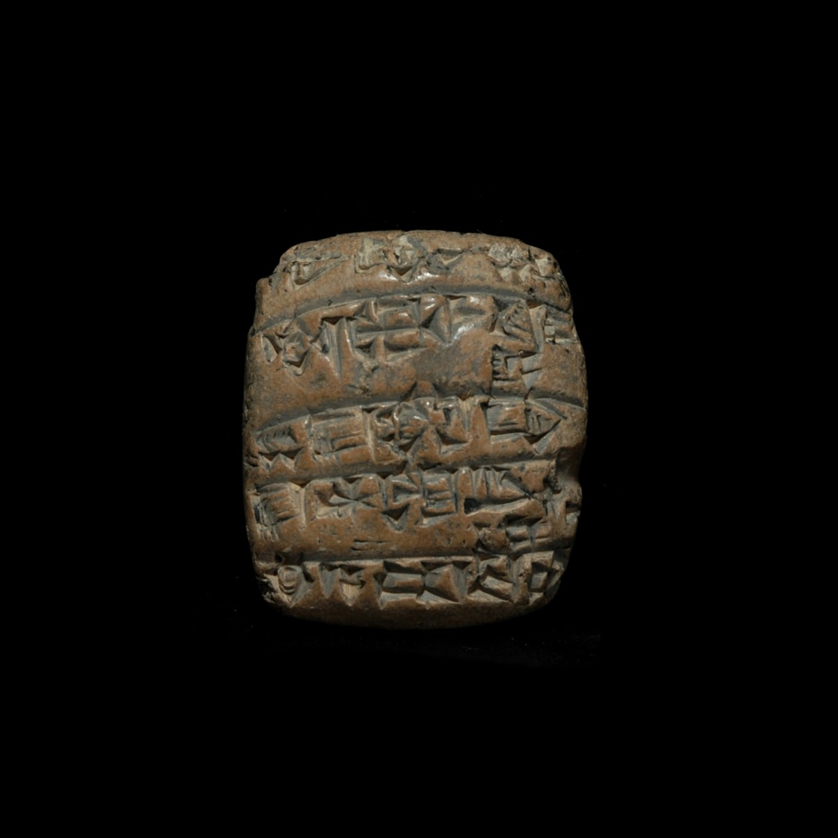 Cuneiform tablet with erased inscription on one side A