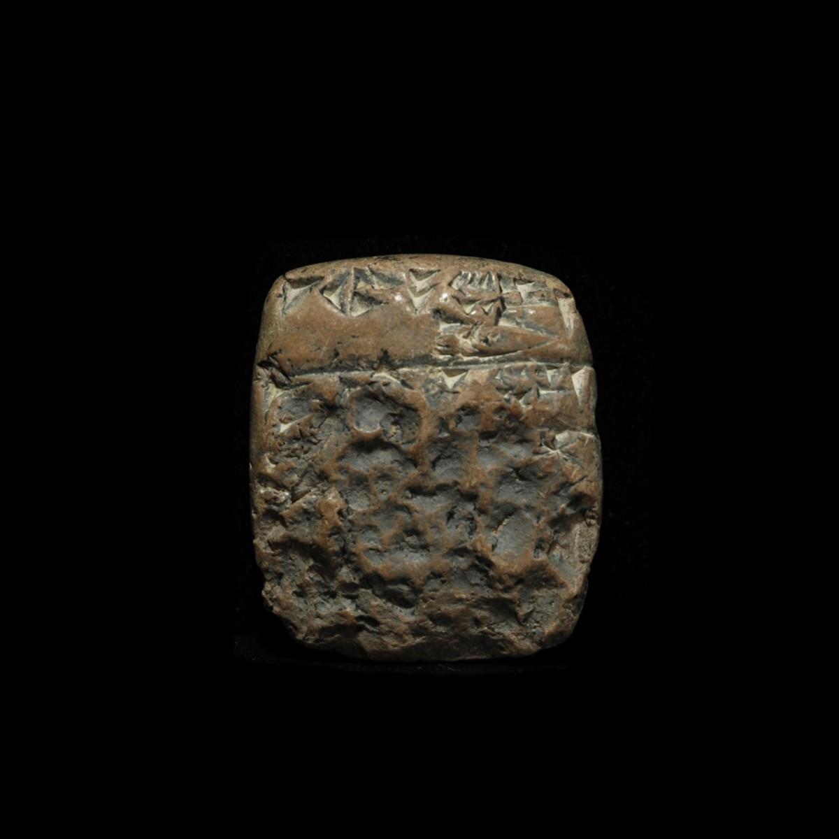 Cuneiform tablet with erased inscription on one side B