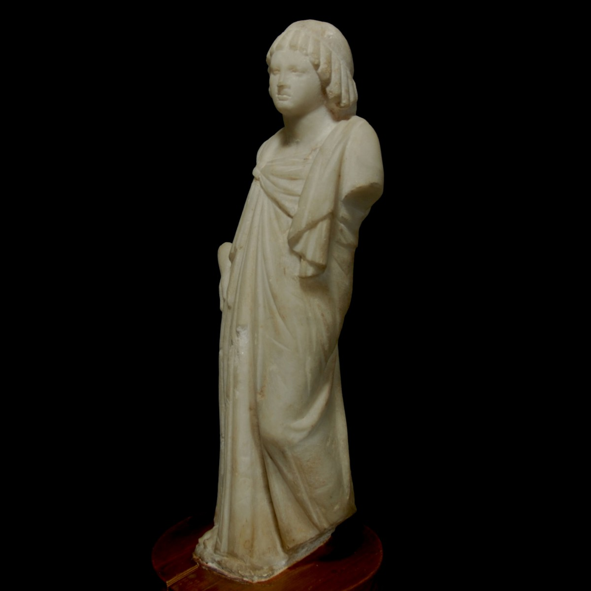 Marble statue of a ptolemaic princess half left