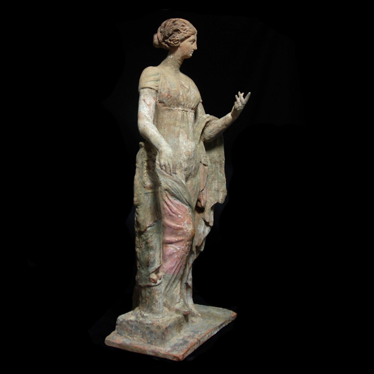 Terracotta statue of Aphrodite leaning on a statue right
