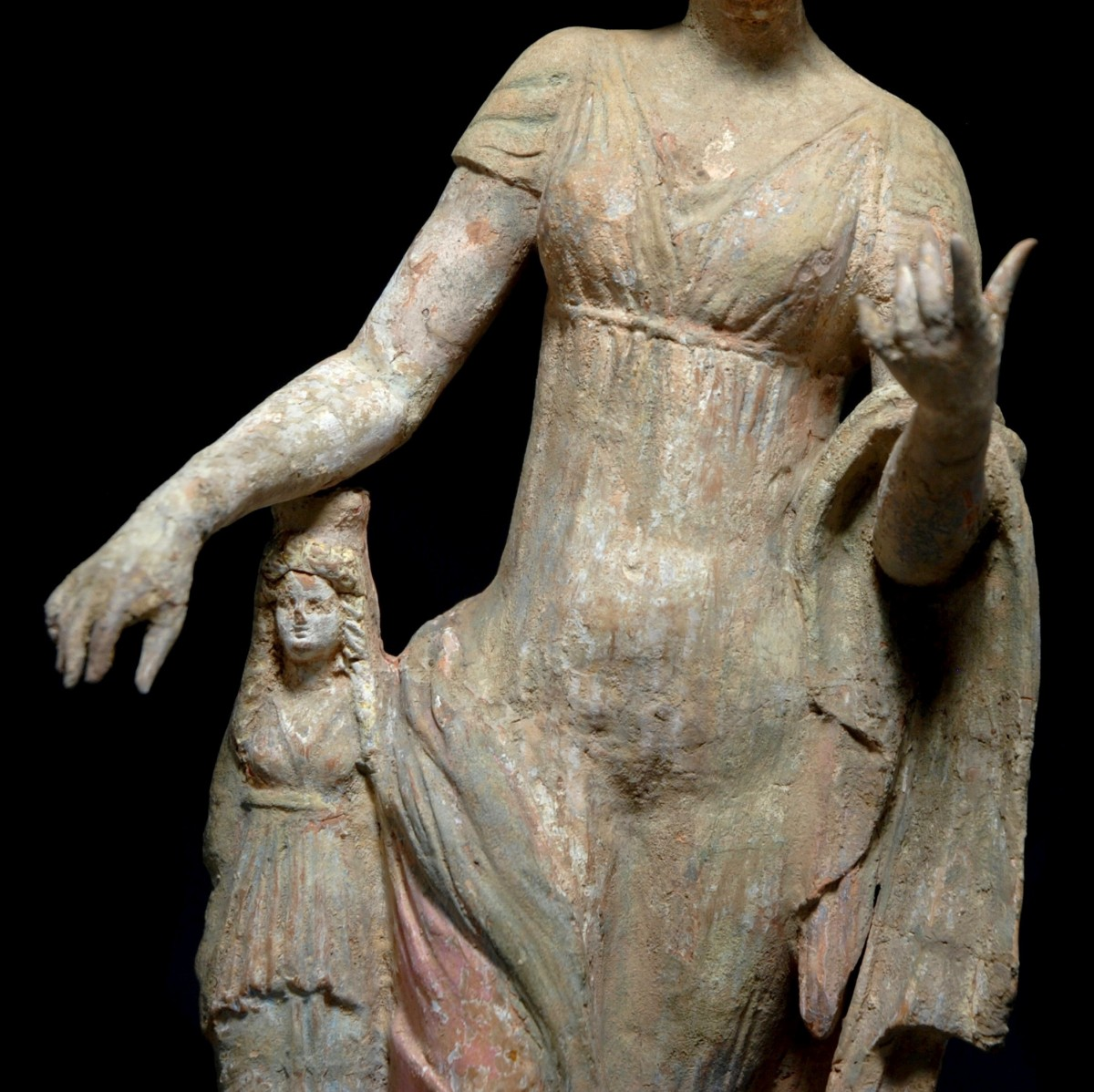 Terracotta statue of aphrodite leaning on a statue detail front