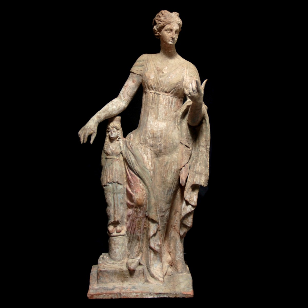 Terracotta statuette of Aphrodite leaning on a statue