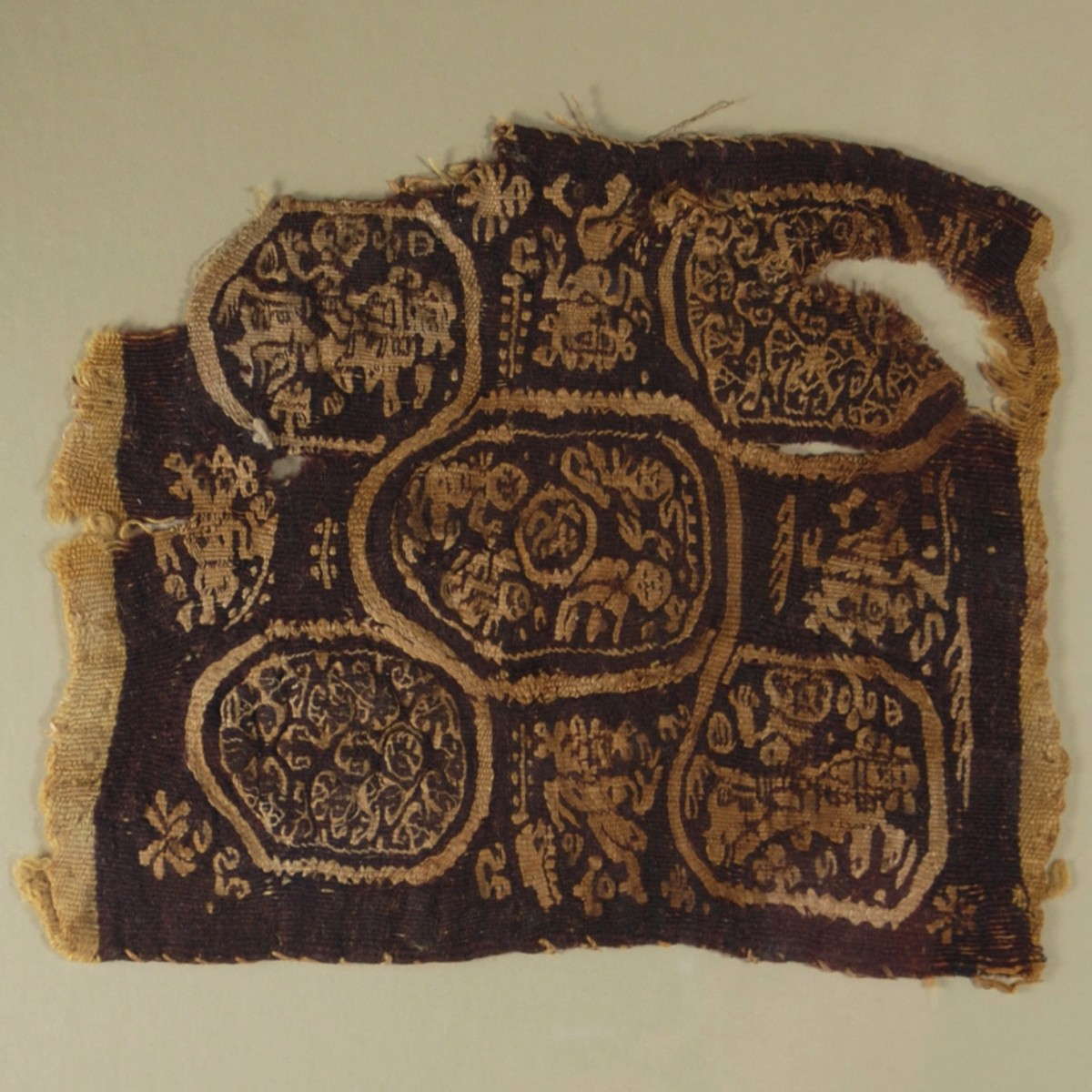 Coptic textile with dancers and riders close