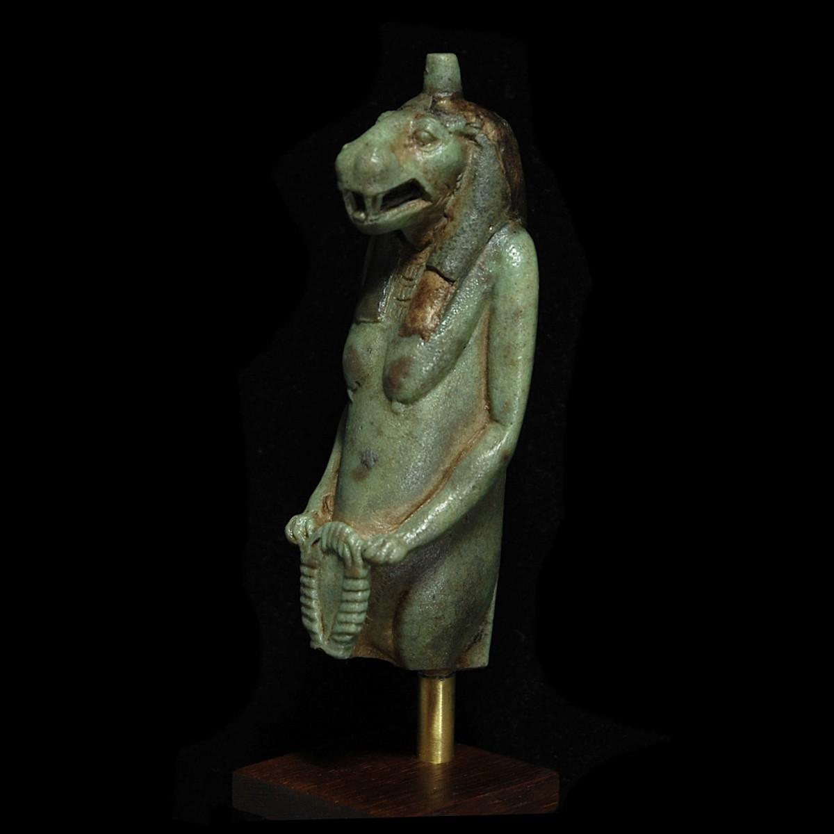 Faience statuette of Taweret half left