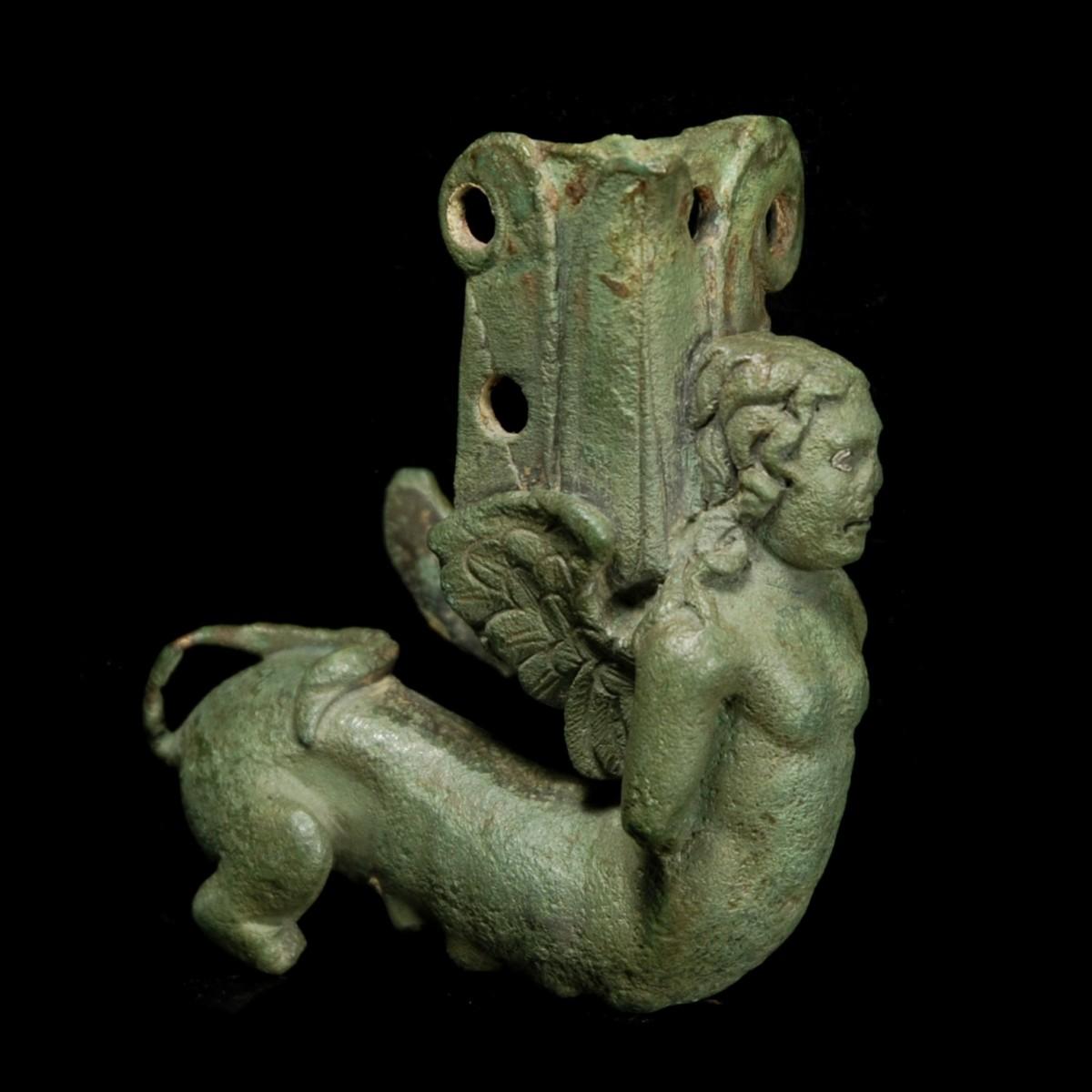 Roman bronze furniture piece in form of a sphinx right
