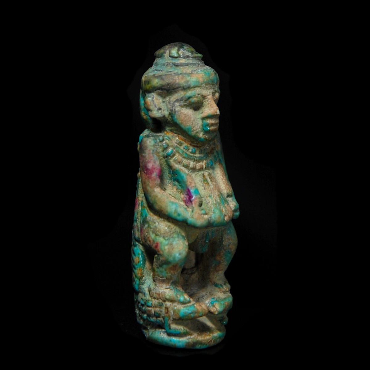 Egyptian Glazed composition figure of pataikos half right