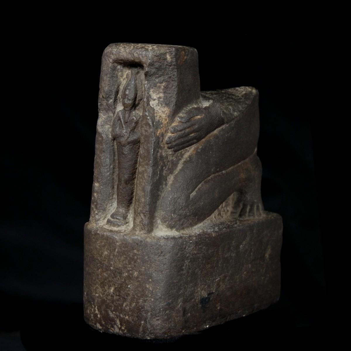 Egyptian Basalt Fragment of a Naophoros half left
