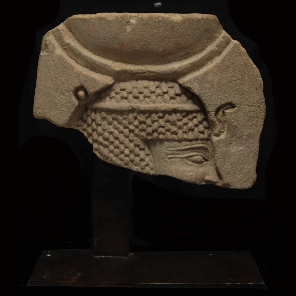 Egyptian limestone relief fragment with pharaoh as Konshu