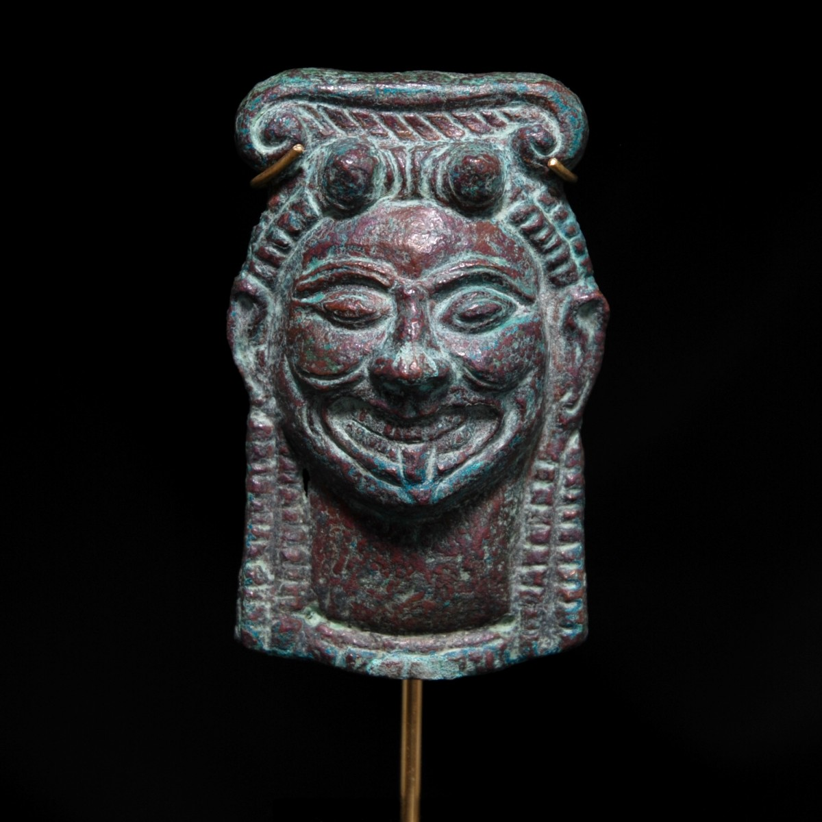 Etruscan bronze applique gorgone head