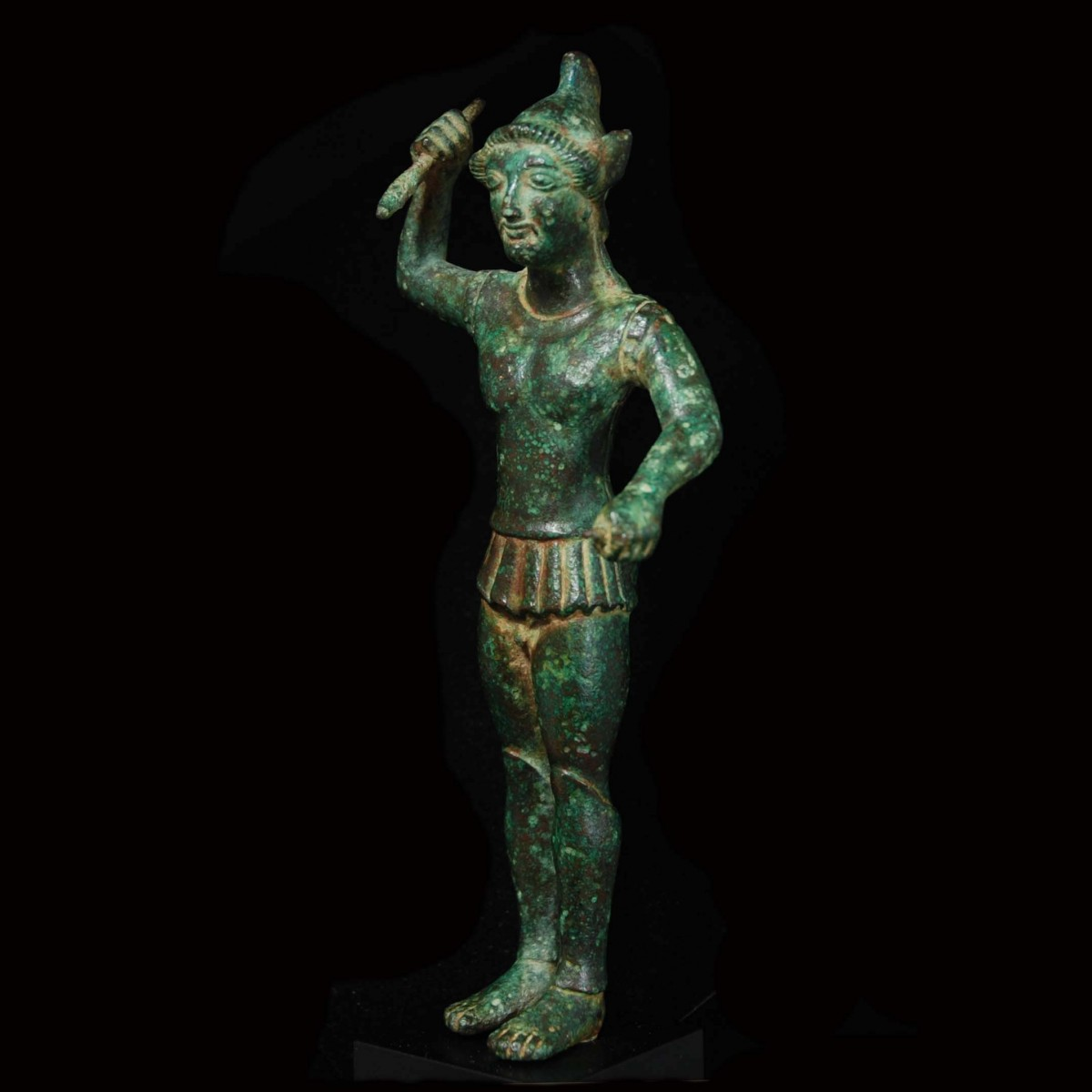 Etruscan Bronze statuette of a warrior half left