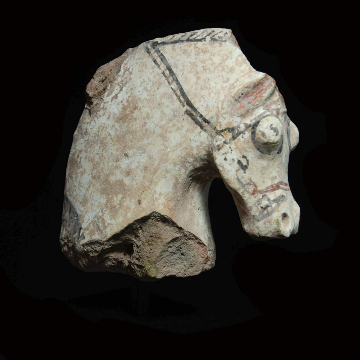 Large Greek terracotta fragment of a horse and rider right