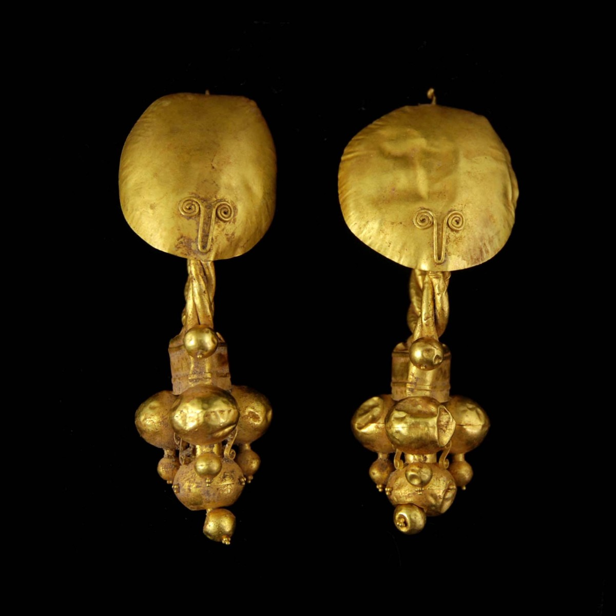 Roman Gold earrings with stilized faces