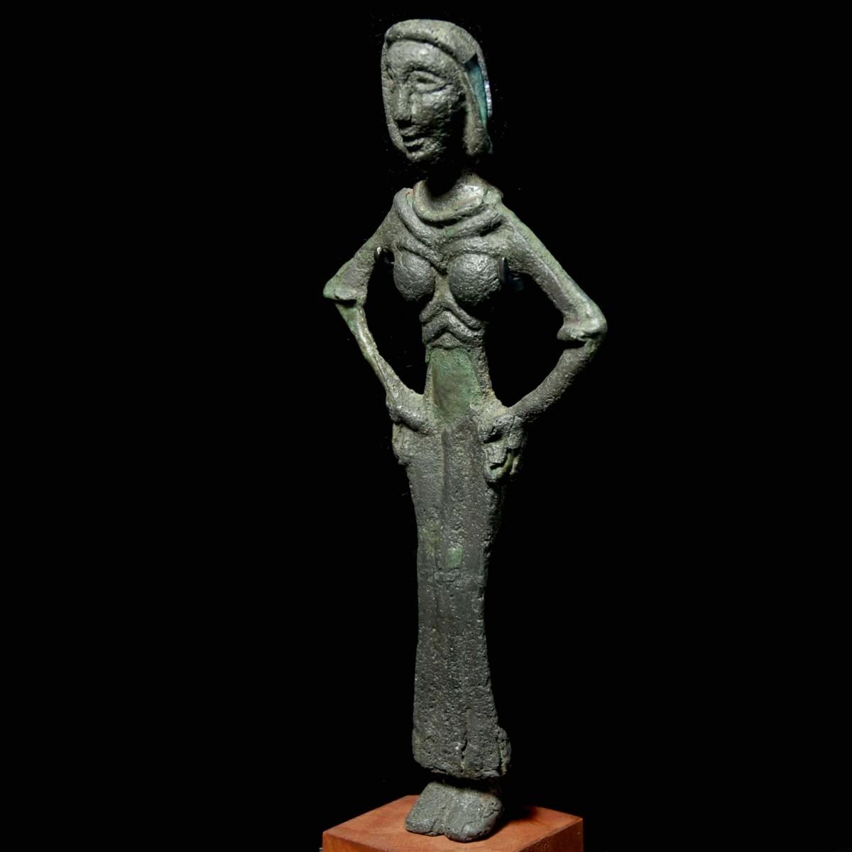 Syrian Female bronze statuette of a fertility goddess half left