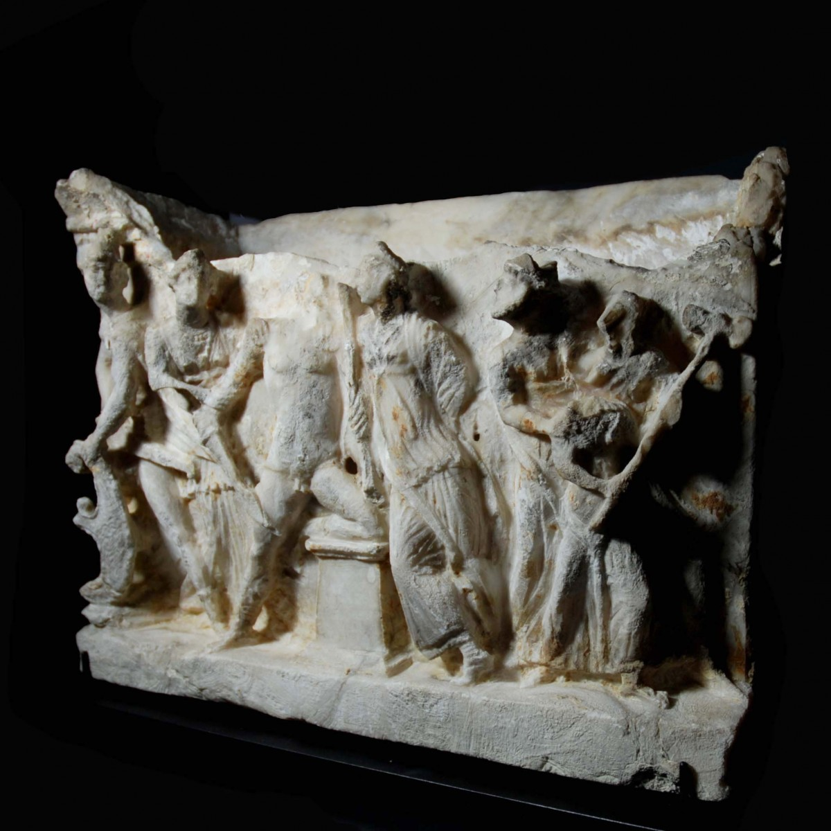 Etruscan alabaster cinerary urn showing the recognition of Paris right