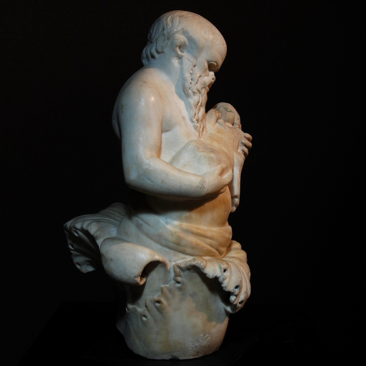 Roman marble statue of Silenus with Bacchus right